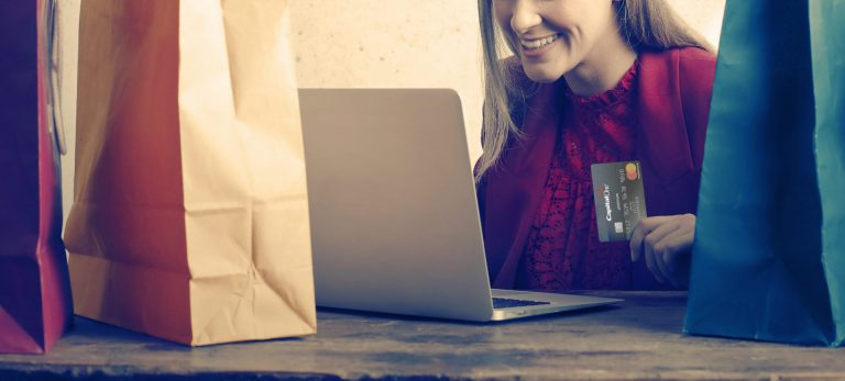 Photo of a Woman shopping online through ecommerce